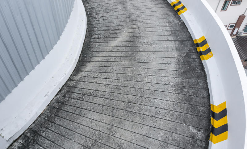 Concrete road ramp parking car garage of garage ramp with yellow lines on the side stock photography