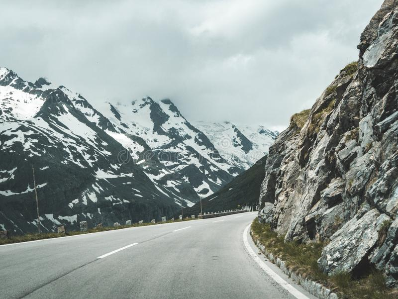 Concrete Road Surrounded Mountains during Golden Hour royalty free stock photo
