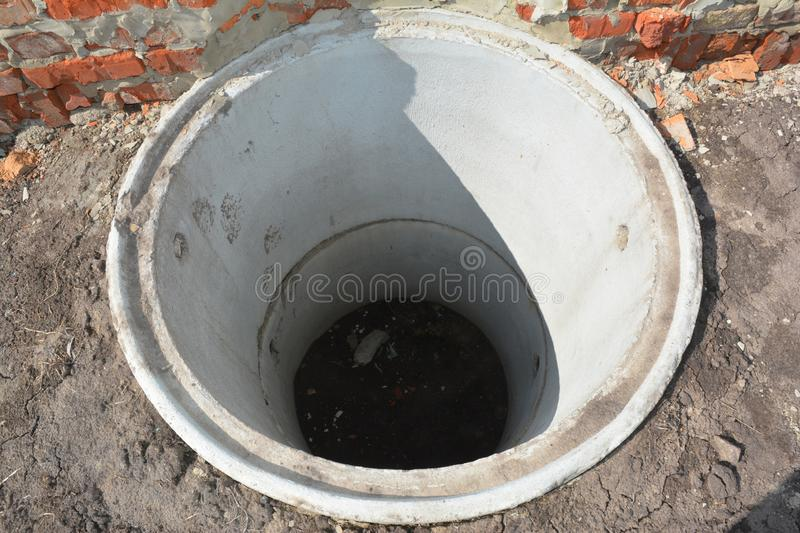 Concrete septic tank. Sewer tank hole installation outdoors royalty free stock image
