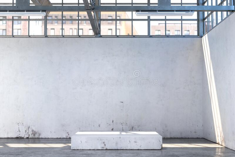 Concrete Showcase In Enlightened White Hangar, Empty Factory Interior or Warehouse With Concrete Floor. stock images