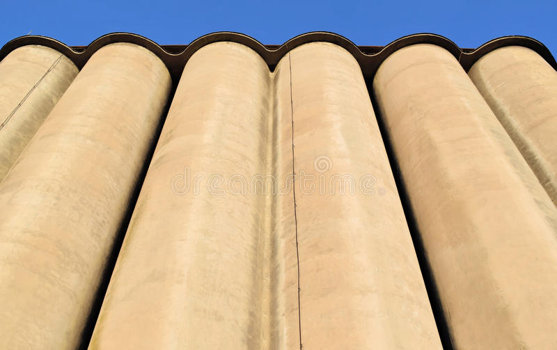 Concrete silos in Europe. Frog`s perspective of an old concrete silos stock image