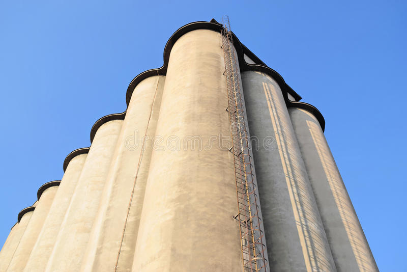Concrete silos in Europe. Frog`s perspective of an old concrete silos royalty free stock photo