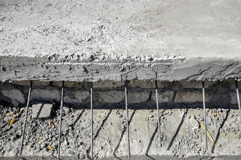 Concrete slab with protruding reinforcing metal rods. Metal fittings for concrete pouring. The technology of building floors stock images