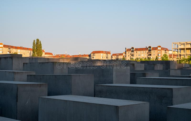 The Memorial to the Murdered Jews of Europe in Berlin Germany designed by Peter Eisenman. Photographed in the late afternoon sun. Concrete slabs at the Memorial royalty free stock photography