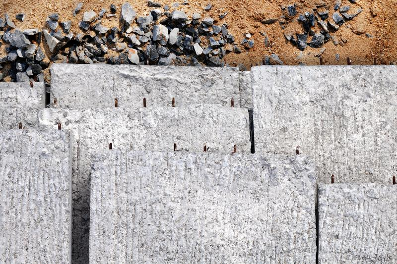 Concrete slabs pile, Texture concrete background, Concrete for construction work on the sand and stones royalty free stock photography