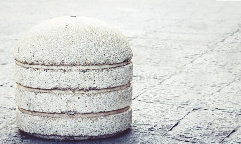 Concrete spheres prohibiting parking barrier on the street in Catania, Sicily, Italy.  stock photography