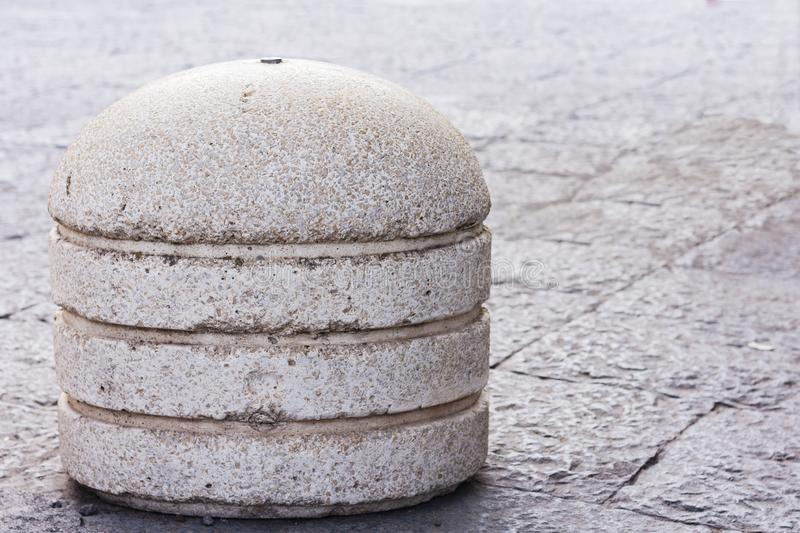 Concrete spheres prohibiting parking barrier on the street in Catania, Sicily, Italy.  stock photo