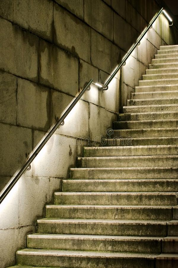 Concrete staircase that is leading upward stock photography
