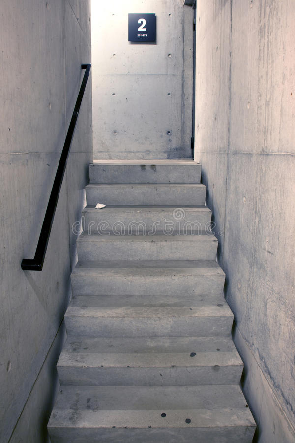 Concrete staircase and stairs leading upwards to second floor. Of parking garage stock images