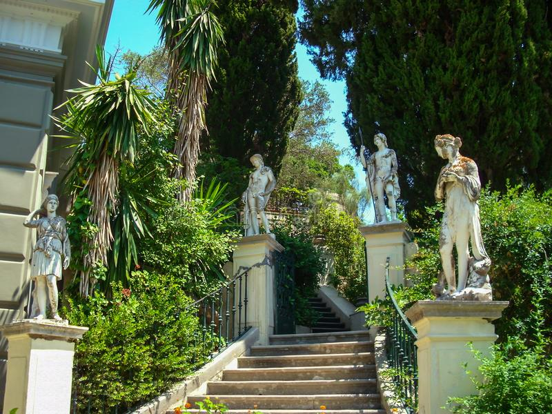 Concrete stairs and concrete statues and big luxurian green vegetation stock photo
