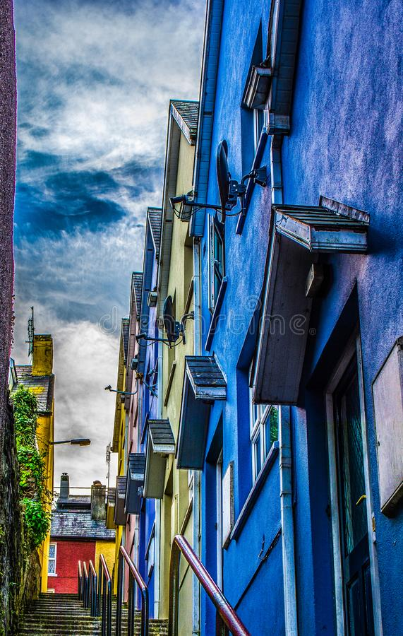 Concrete Steps Beside Blue, Yellow, and Purple Concrete Structures Under Cloudy Sky stock image