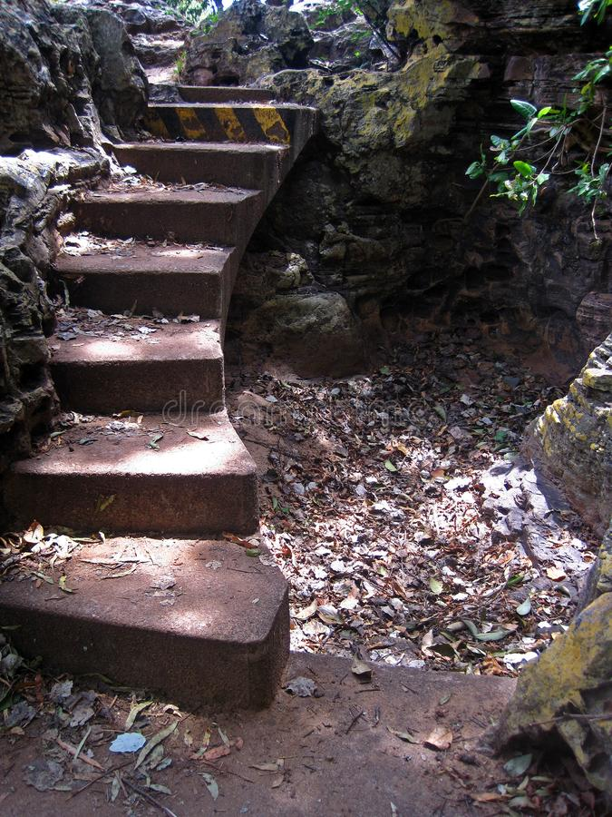 CONCRETE STEPS LEADING TO HIGHER GROUND. View of a set of concrete steps in the outdoors accessing higher ground stock photo