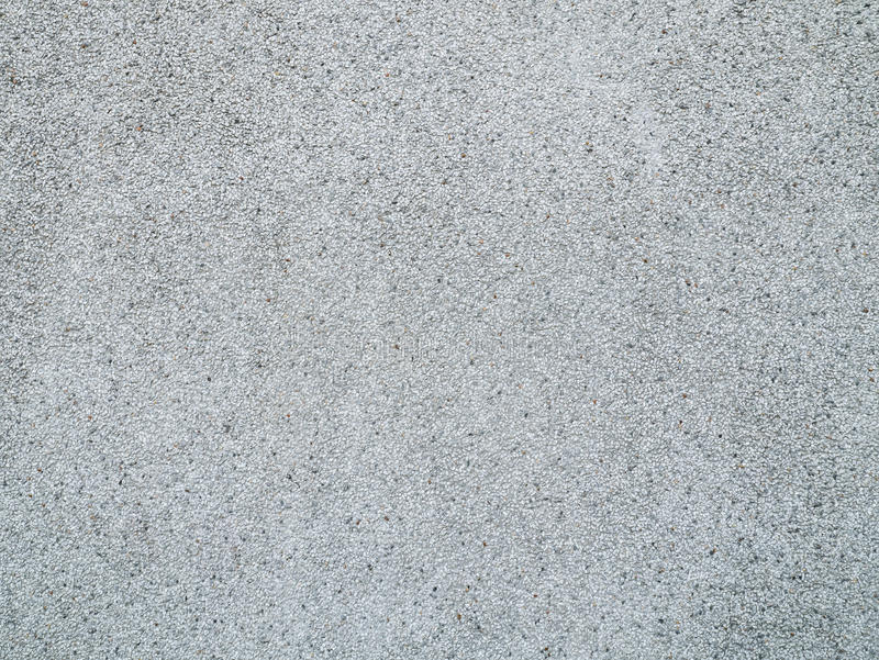 Concrete stone pebbles wall background texture. royalty free stock image