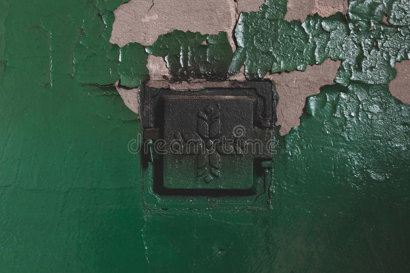 Concrete stove with closed metal doors stock photos