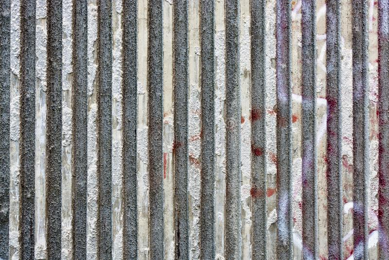 Concrete stripy wall. Grey stripy concrete outdoors wall background stock image