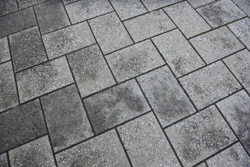 Concrete tiled pavement background. An Concrete tiled pavement background stock photos