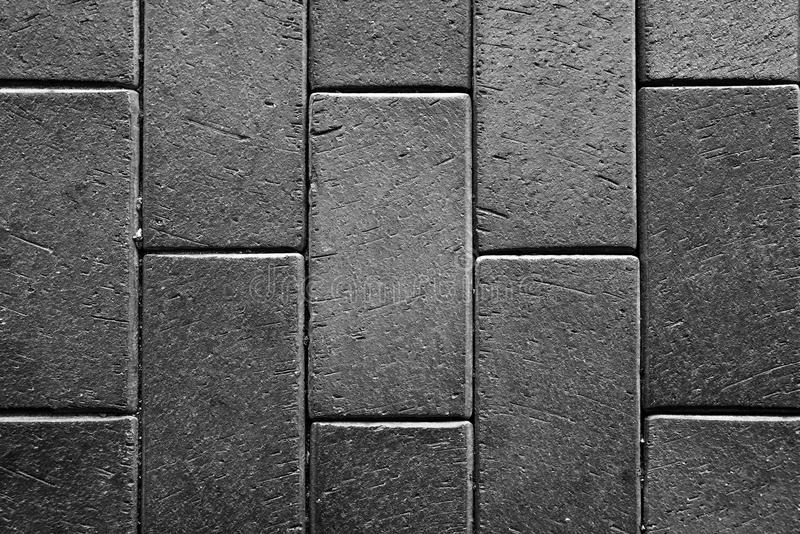 Concrete tiled pavement background. Texture royalty free stock photo
