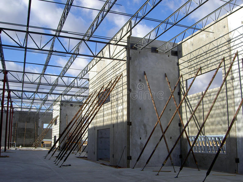 Concrete tilt-up. Engineered braces hold concrete panels in place until the roof structure is installed to stabilize the building walls royalty free stock image