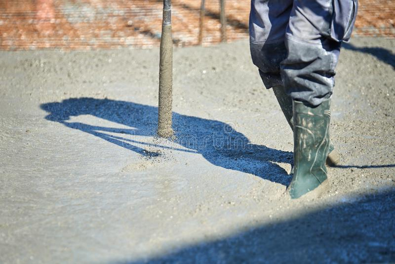 Concrete Vibrator being used on a construction site stock photography