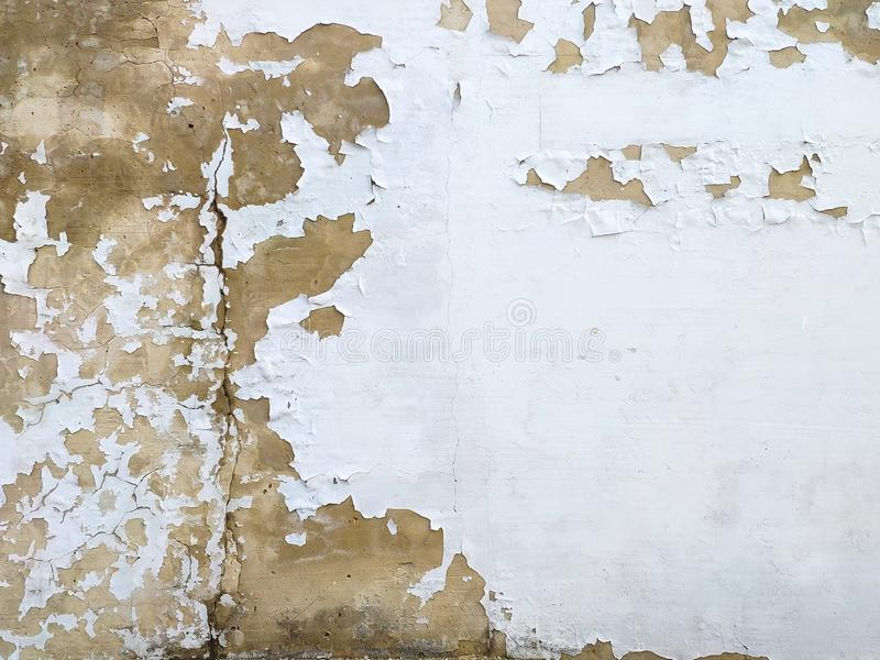Concrete wall cracked paint, paint abstractly behind the concrete. Texture, pattern, background. old paint royalty free stock photo