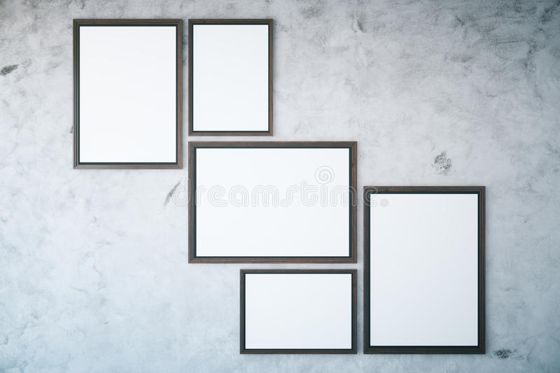 Concrete wall with empty frames royalty free illustration