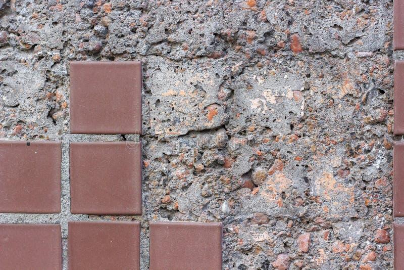 Concrete wall with fallen mosaic stock photos