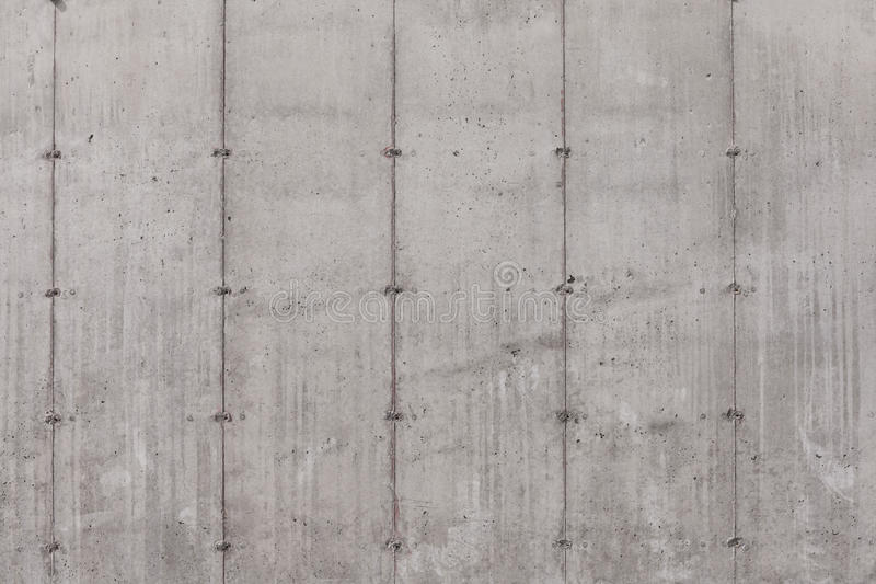 Concrete wall. Grey concrete wall with no finished texture except the print of the concrete forms stock image