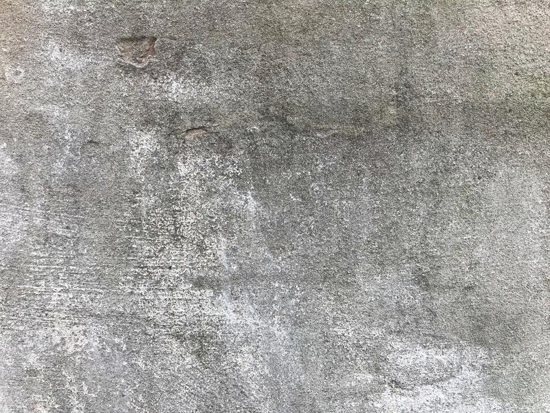 A concrete wall that has a smooth surface over almost the entire area. Great background for your needs royalty free stock image