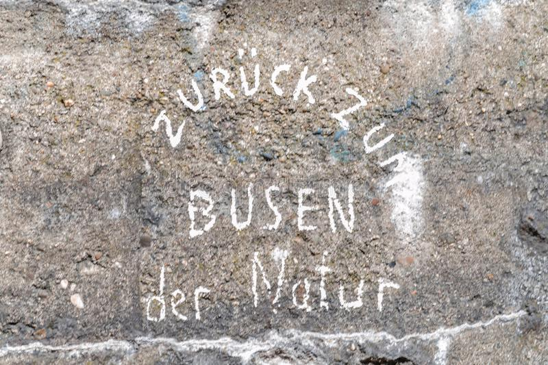 Concrete wall with inscription. Of the Figure of speech in German, the yellow of the egg stock photos