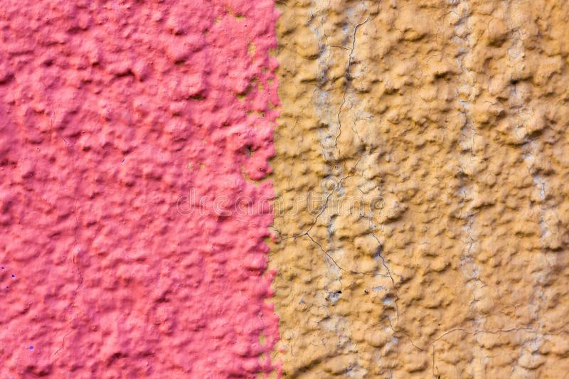 The concrete wall is painted in two colors of pink and orange. stock photos