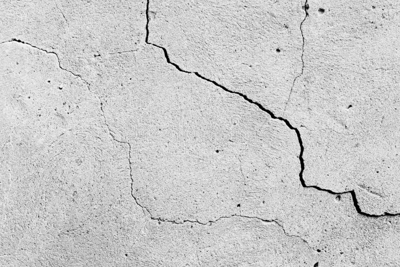 Concrete wall texture background. Old cement surface with cracks and scratches as grunge background. Black and white image stock photo