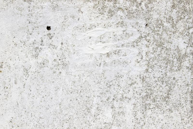 Old concrete wall with a layer of whitewash, stucco texture stock image