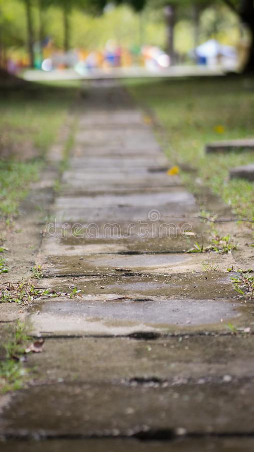 Concrete water drain covers or also known as a ditch. Concrete water drain covers or also known as a ditch on the road between green grasses stock images