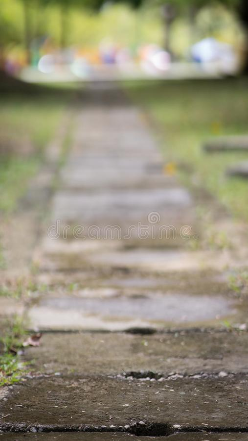Concrete water drain covers or also known as a ditch. Concrete water drain covers or also known as a ditch on the road between green grasses royalty free stock photography