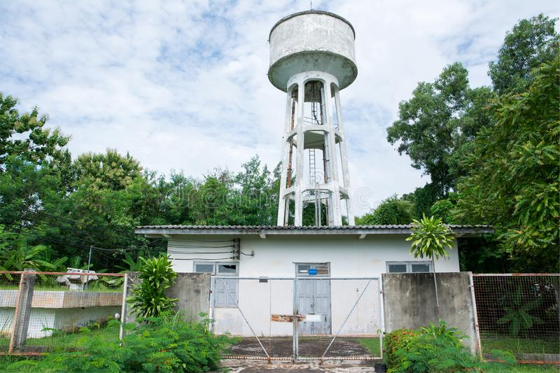 Concrete water tank tower factory in the garden stock images
