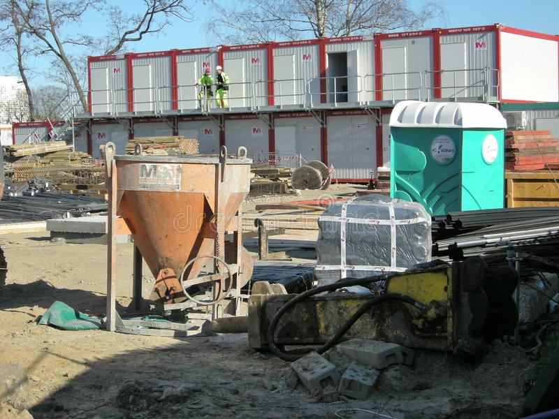 Concrete works at construction site. Concrete works finished after woring day at construction site. Container for concerete mix on the left, plastic portable stock photo