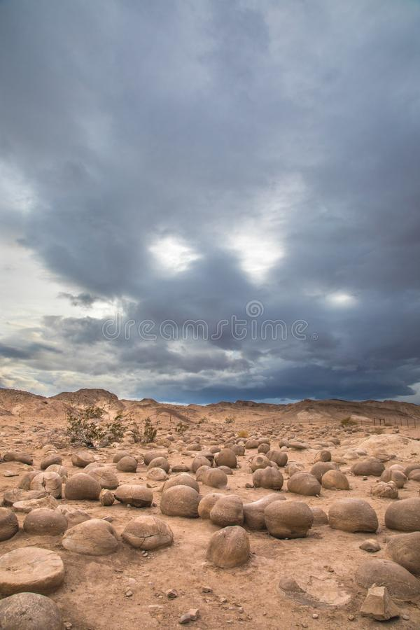 Concretions. Pumkin Sized Sandstone Concretions Eroded From Desert Floor With Stormy Sky At Ocotillo Wells State Vehicular Recreation Area, California stock photos