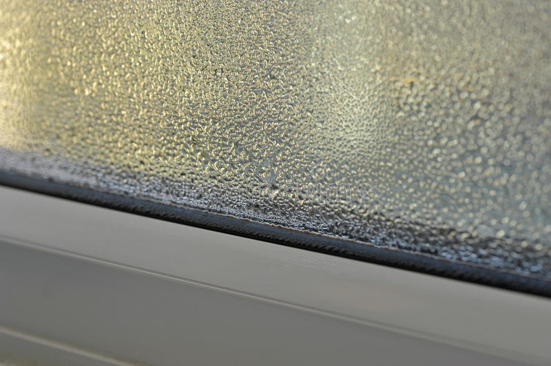Condensation. And damp problem on the inside of a double glazed window royalty free stock image