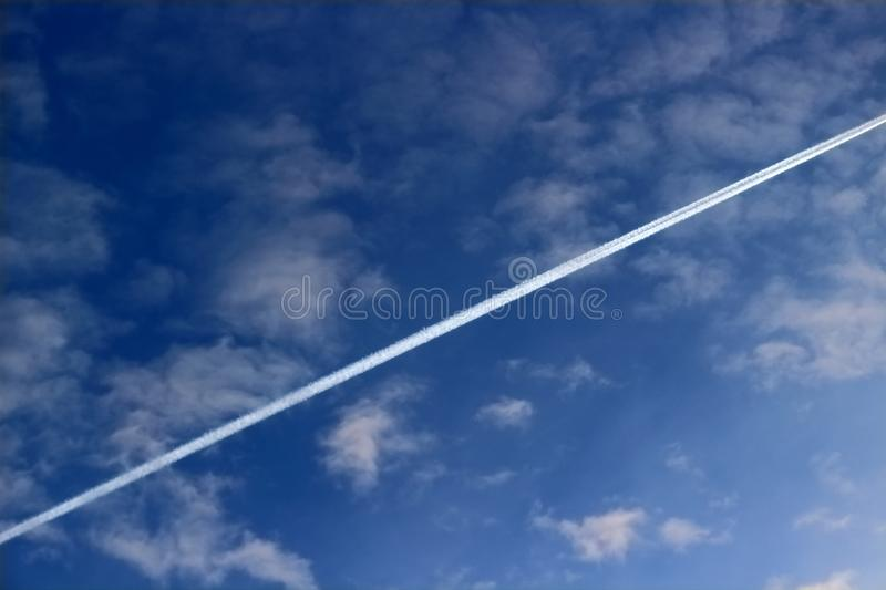 Condensation line from engine exhaust aircraft stock photo