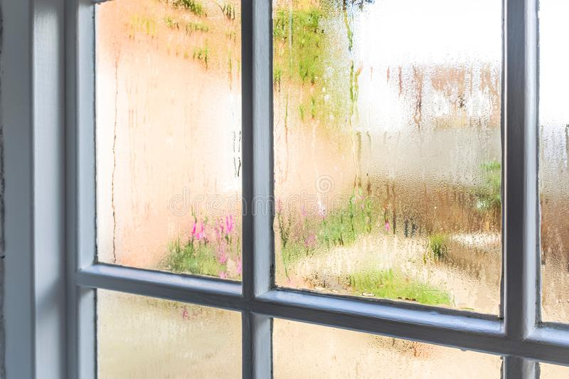 Condensation on old window panes stock image