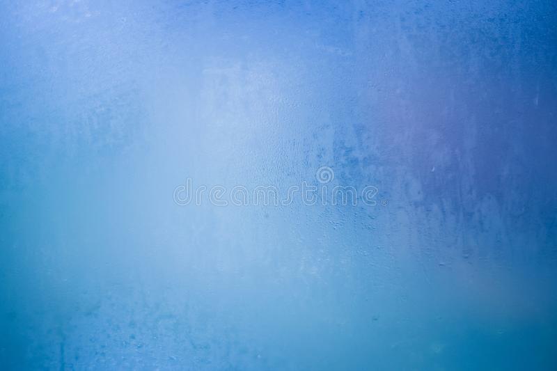 Condensed water on the window glass. Blue texture background of water on window stock photography