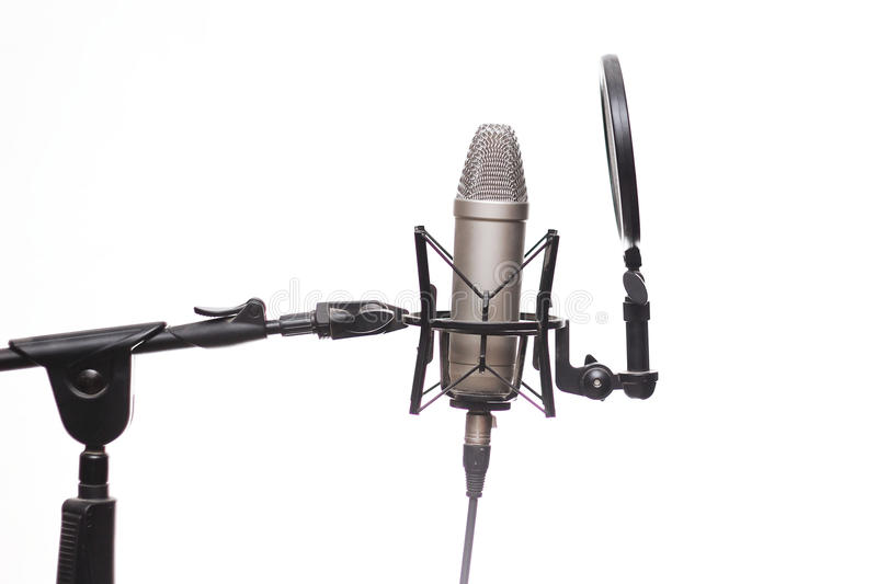 Condenser Mic On Stand In Studio Isolated On White. Quality Condenser Mic On Stand In Studio Isolated On White stock images