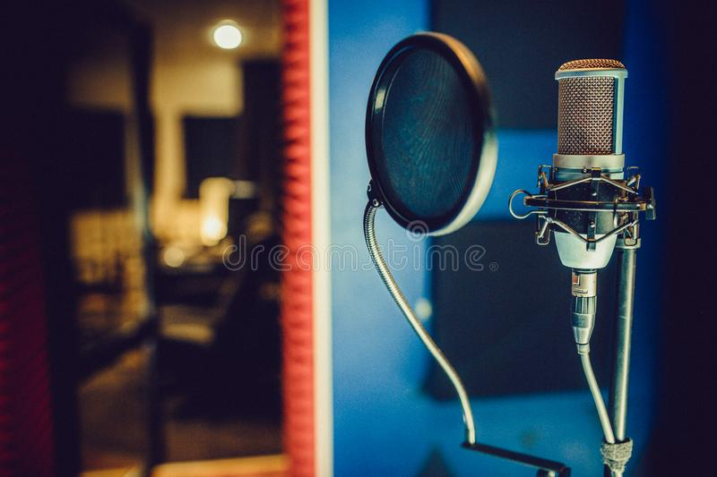 Condenser microphone in a recording studio, pop filter royalty free stock image