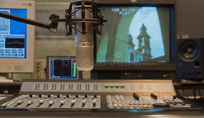 Condenser microphone in TV production studio interior. Professional condenser microphone in TV production studio interior royalty free stock photo