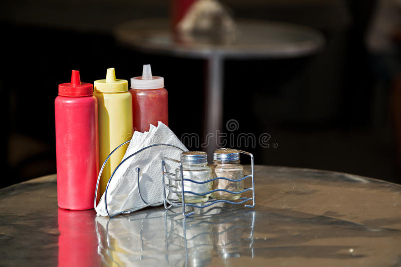 Condiments and napkins. Russia. Condiments and napkins on the table in the street cafes. Russia stock photography
