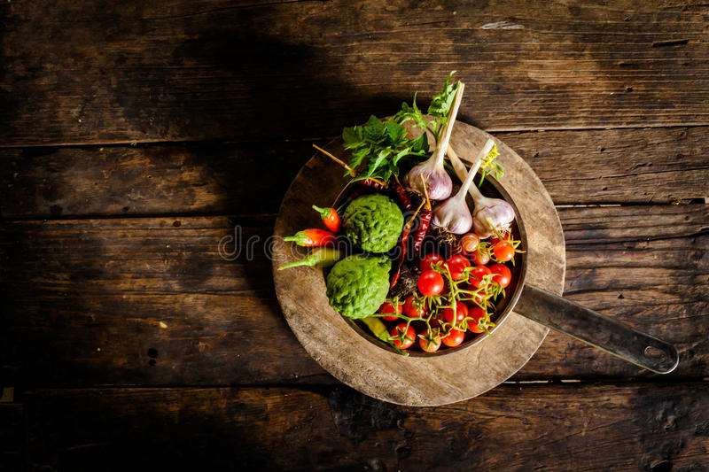 Condiments and spices for creative cooking on dark rustic wooden stock photo