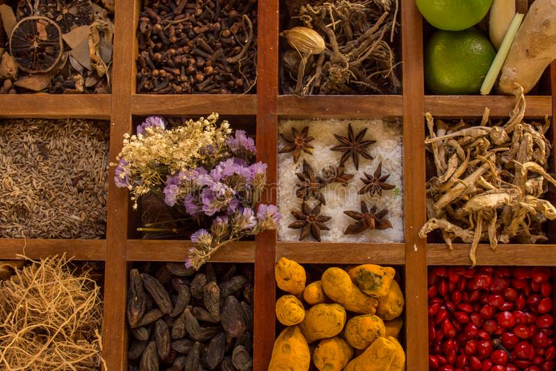 Condiments and spices in the wooden box royalty free stock photography