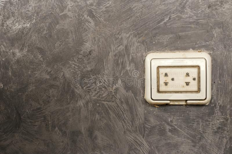 The condition of electrical outlets on the outside of the building and is protected by a plastic cover. royalty free stock images