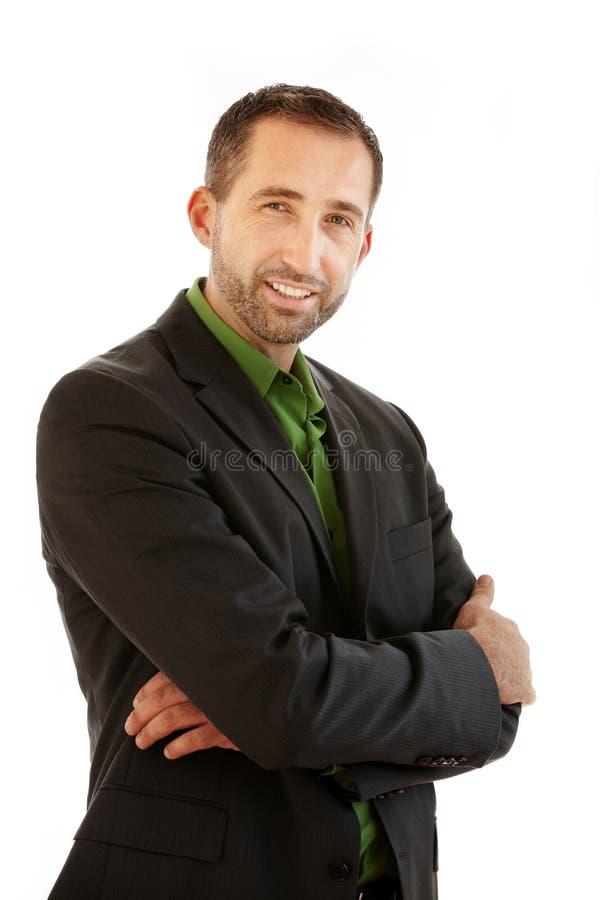 Condizione bella dell'uomo d'affari in un vestito e nei sorrisi immagini stock libere da diritti