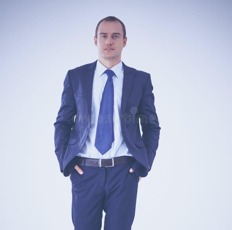 Condizione felice dell'uomo d'affari isolata su fondo bianco fotografia stock